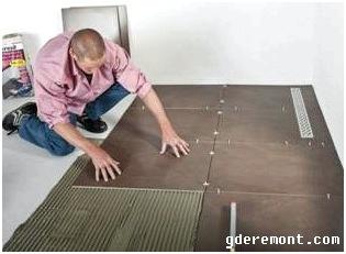 Укладка большой плитки на пол