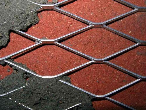 Штукатурка кирпичной стены по сетке