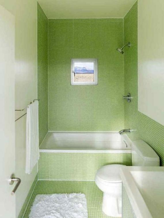 Интерьер оформлен зеленой мозаичной плиткой